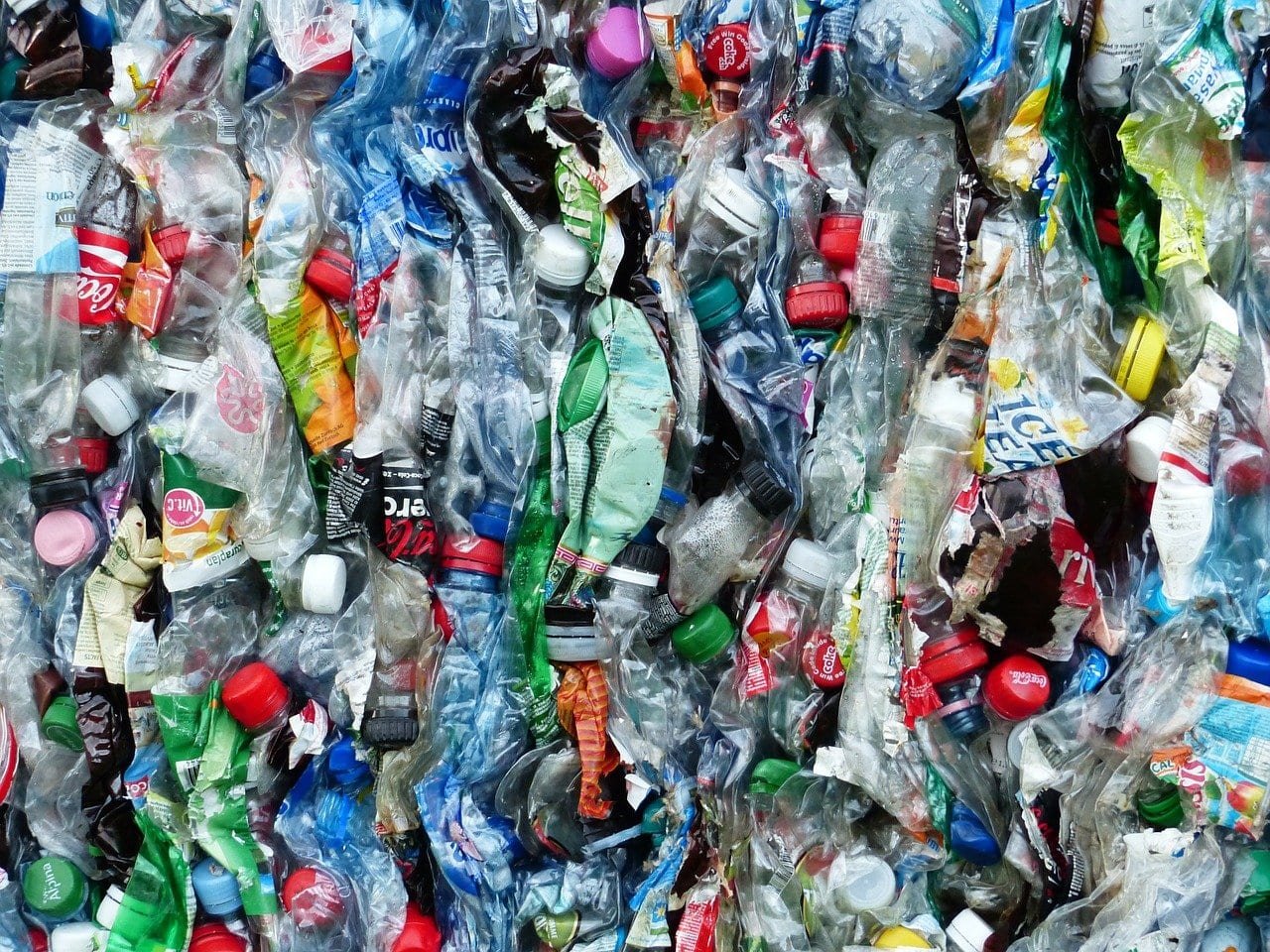 This picture is completely filled with used and crumpled plastic bottles