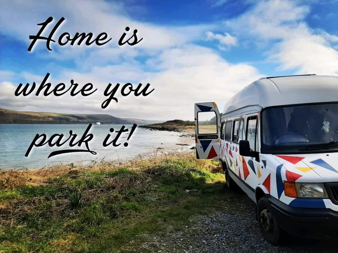 A picture of Steffanie's van next to a waterway with the caption: home is where you park it!